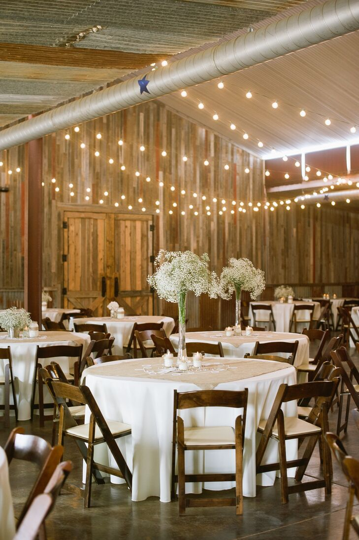 """""""We made a lot of our own decorations and centerpieces, which was a lot of fun and made everything very personal,"""" says the bride. Centerpieces featured displays of baby's breath, cotton and pearl strands."""
