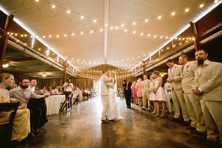 """""""We wanted our wedding to be fun and for us to be able to spend time with our family and friends,"""" says Jaclyn. The couple shared their first dance in a beautiful barn of refurbished wood and string lights."""