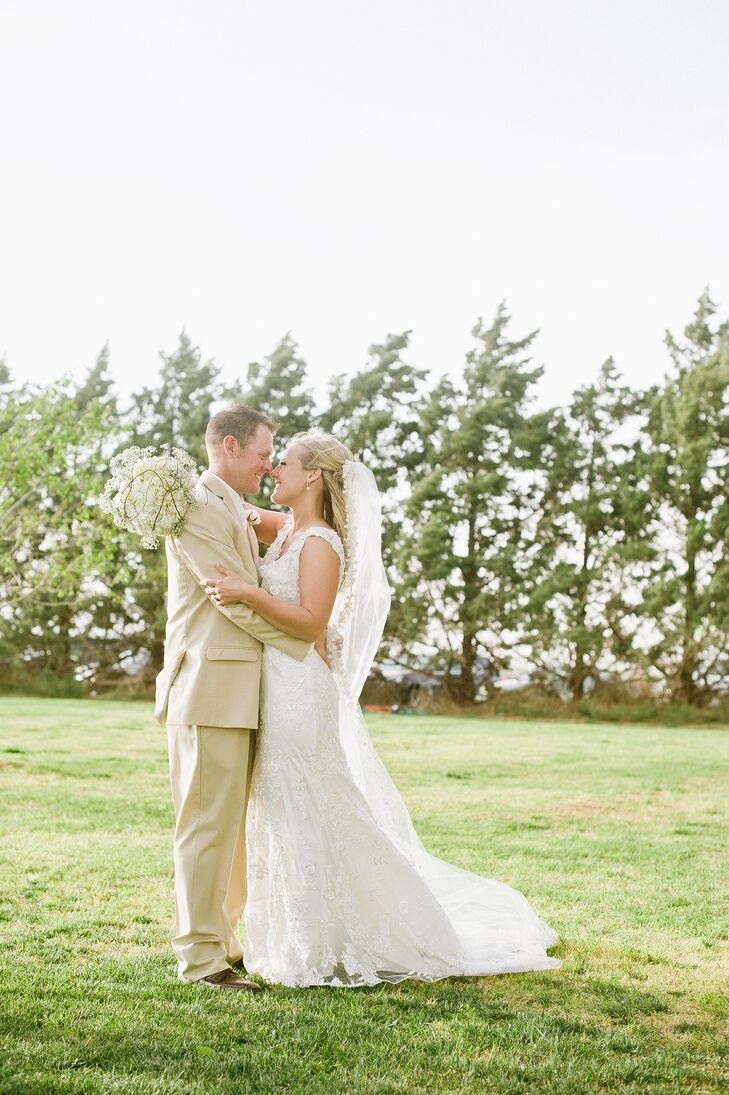 """""""My dress was everything I had imagined it would be,"""" says Jaclyn. She wore a form-fitting lace dress with a v-neck and a beautiful veil outlined in the same lace as the dress."""