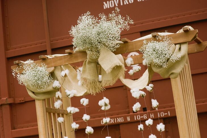 The wedding arbor featured bunches of baby's breath and garlands of natural cotton bolls.