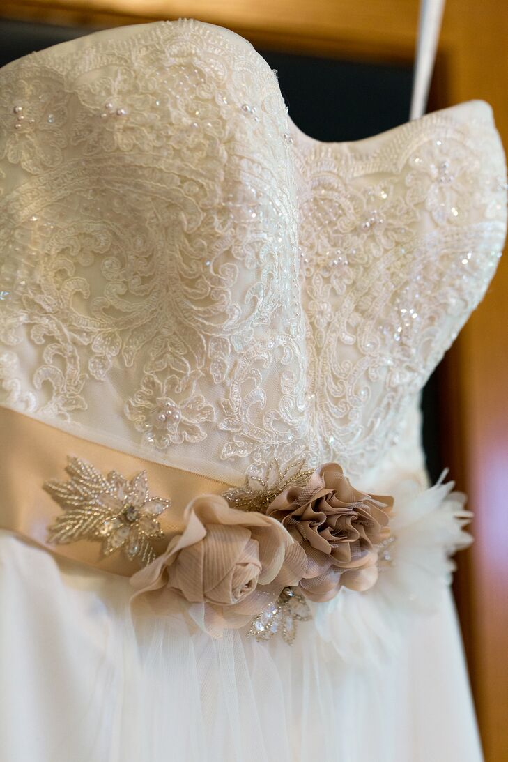 """Katelyn's intricately beaded gown and an embellished champagne sash inspired a bohemian feel for the day's decor. """"The dress set the tone for the entire wedding,"""" she says."""