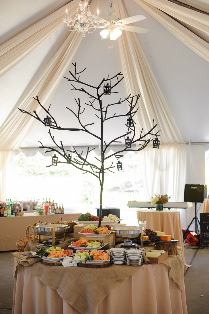 This is one way to make your fruit and cheese station stand out! Bringing in their garden-style decor with a modern twist, Sarah and Tom highlighted their station with a metal tree, matching lanterns and wooden bases. The burlap overlay and neutral linens added to the natural decor at the Old Mill in Rose Valley, Pennsylvania.