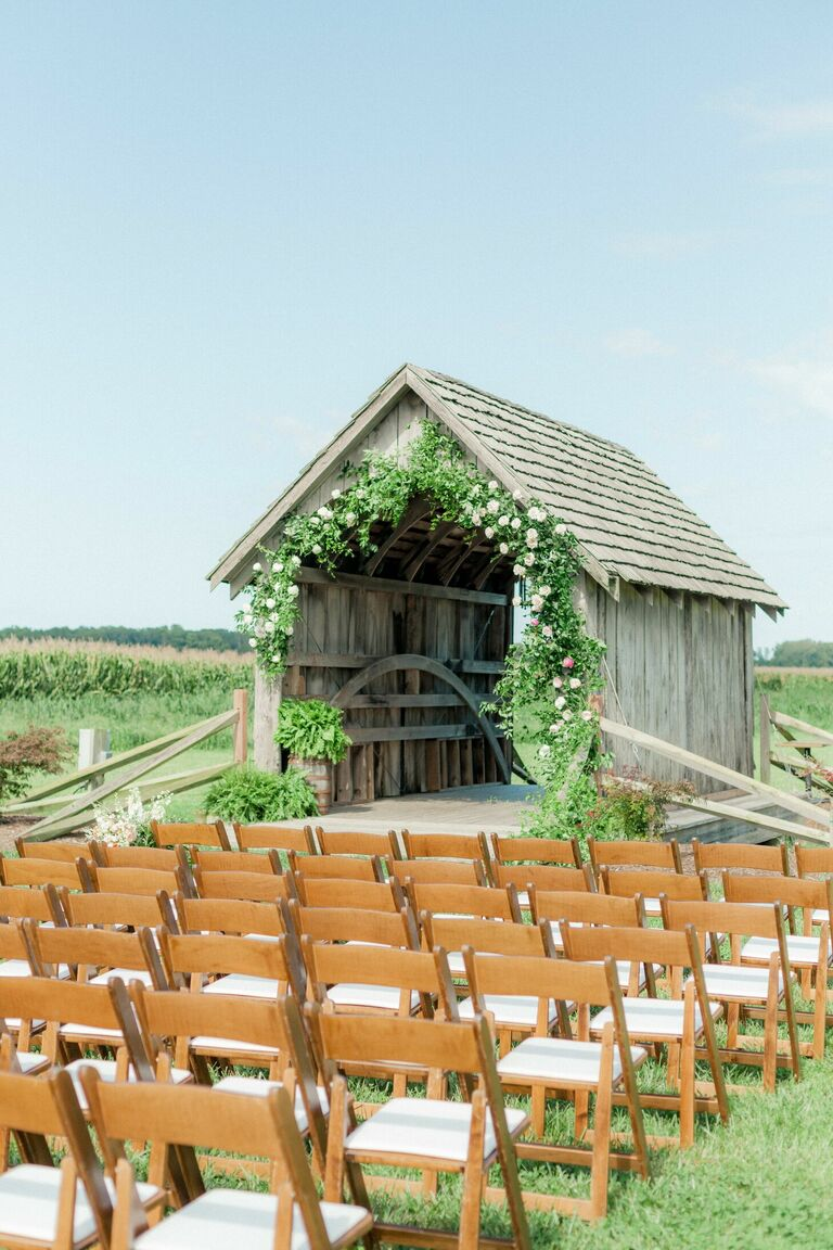 Wedding ceremony in front of a covered bridge