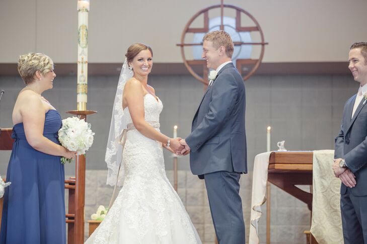 """Tricia and David's traditional Catholic wedding Mass was at the church they attended. """"Our priest made the ceremony so personal,"""" Tricia says."""