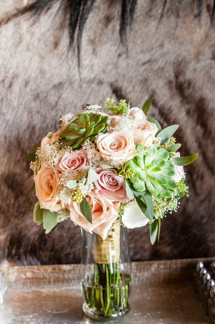 Melissa carried this romantic bouquet of queen anne's lace, roses and succulents down the aisle.