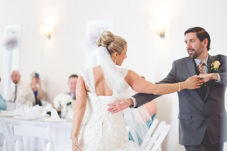"""As a surprise to their guests, Mandy and Jesse took ballroom lessons before their wedding day and performed a choreographed first dance. """"We wanted to surprise our families, and boy were they surprised,"""" Mandy says."""
