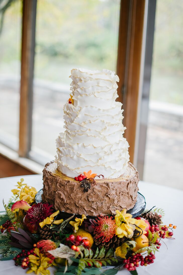 Each layer of the four-tier buttercream cake was different, including a fall-flavored portion of caramel apple cake with fresh apple compote.