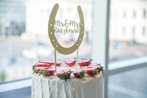 White Round Cake with Strawberries and Horseshoe Topper