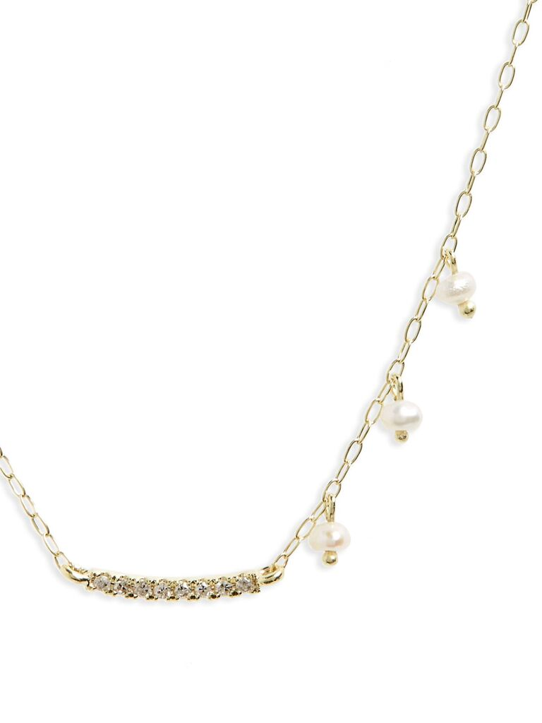Asymmetrical pearl and diamond bridal necklace