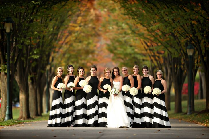 We love these unique bridesmaid dresses! Kieran's bridesmaids wore black floor-length dresses that featured graphic white chevron stripes and halter necklines. Together, the bridesmaids made a bold statement and added a modern edge to the classic wedding while still adhering to the black-and-white color palette.