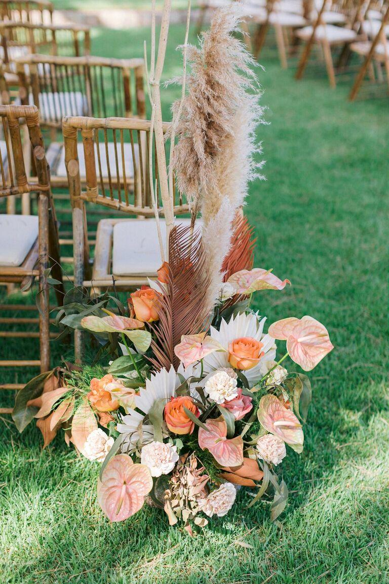 Aisle arrangement with orange anthurium and pampas grass