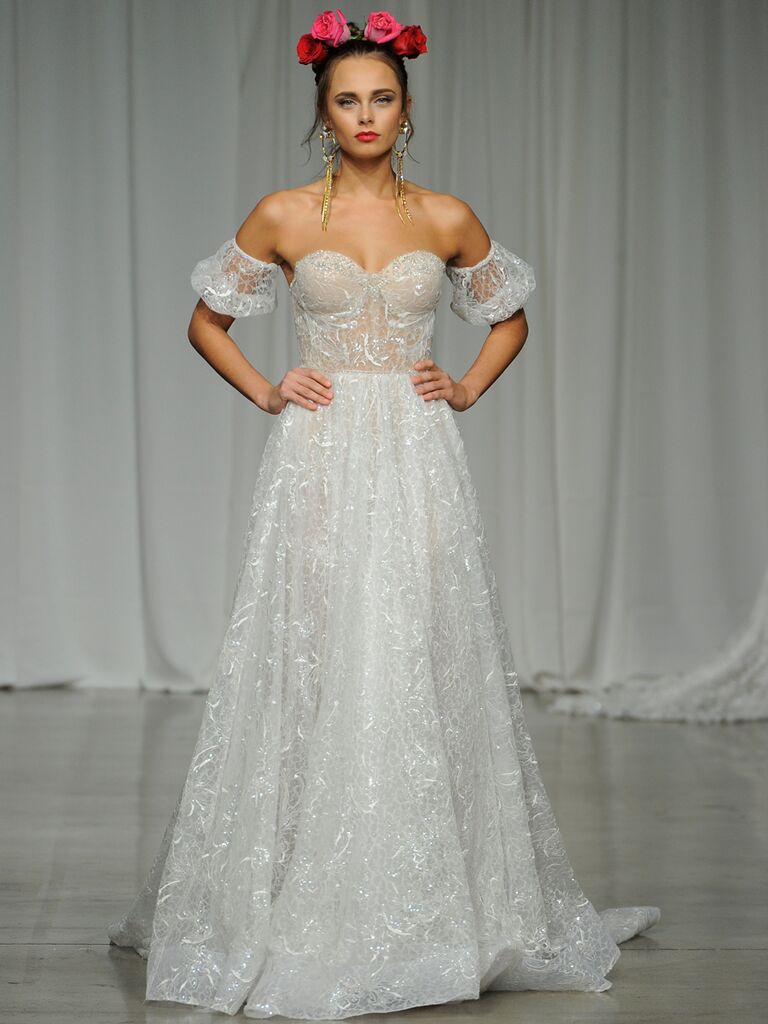 Julie Vino Spring 2019 A-line wedding dress with a corseted bodice and lace shoulder details