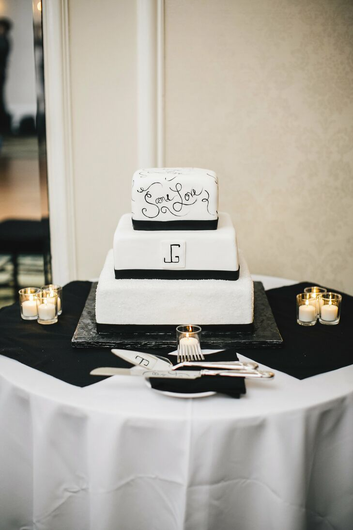 The couple added a special touch to their modern black and white fondant cake; the top layer was decorated with handed painted love phrases like Same Love.
