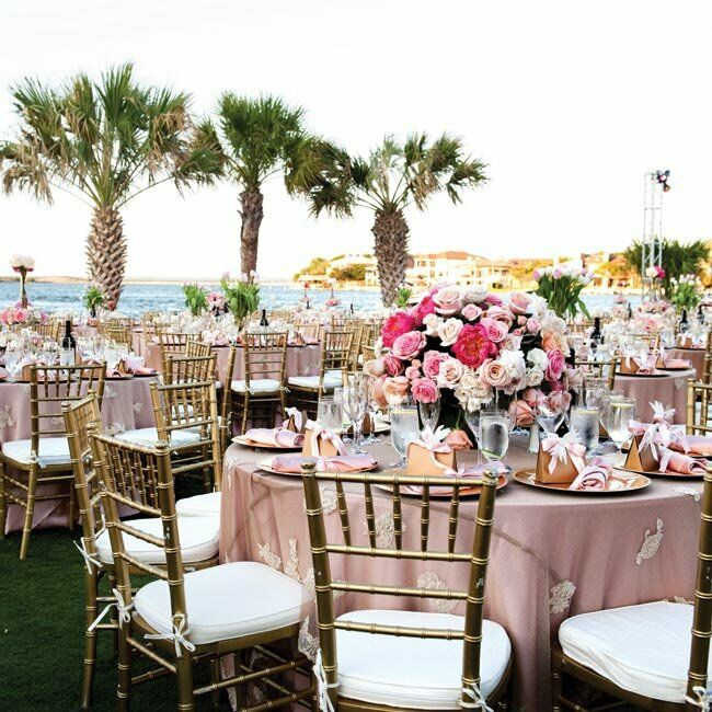 Varying shades of pink in the centerpieces and linens gave the tables visual depth.