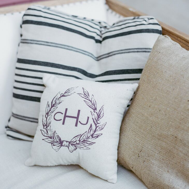 Katie and Jamie dressed up their cocktail hour with custom monogrammed pillows to add a more personal element to the evening.  This monogram was introduced with our formal wedding invitation and we used it as way to seamlessly tie together various aspects of our wedding, says Katie.