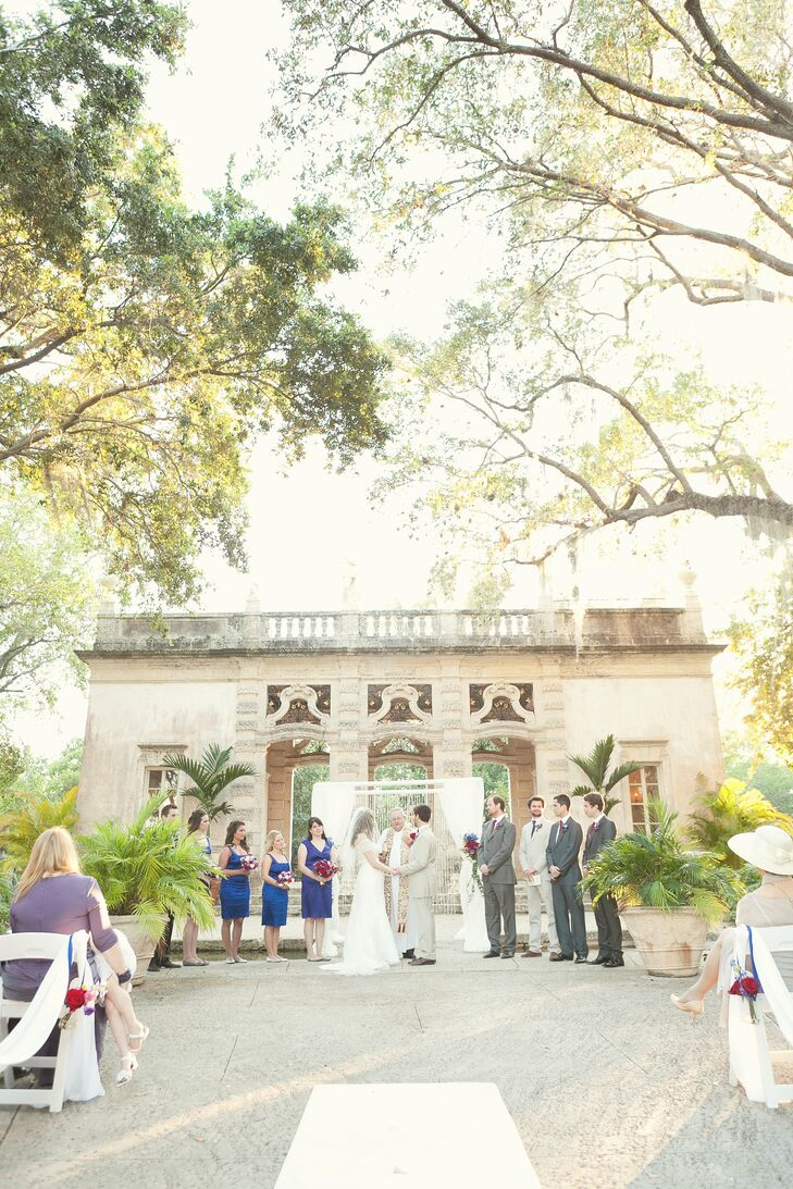 The couple exchanged vows in a romantic garden under a canopy of Spanish moss.