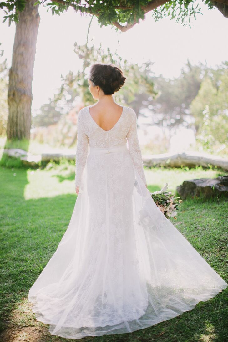 Rory altered her long-sleeve Chantilly lace Monique Lhullier gown to have a lower-cut back.