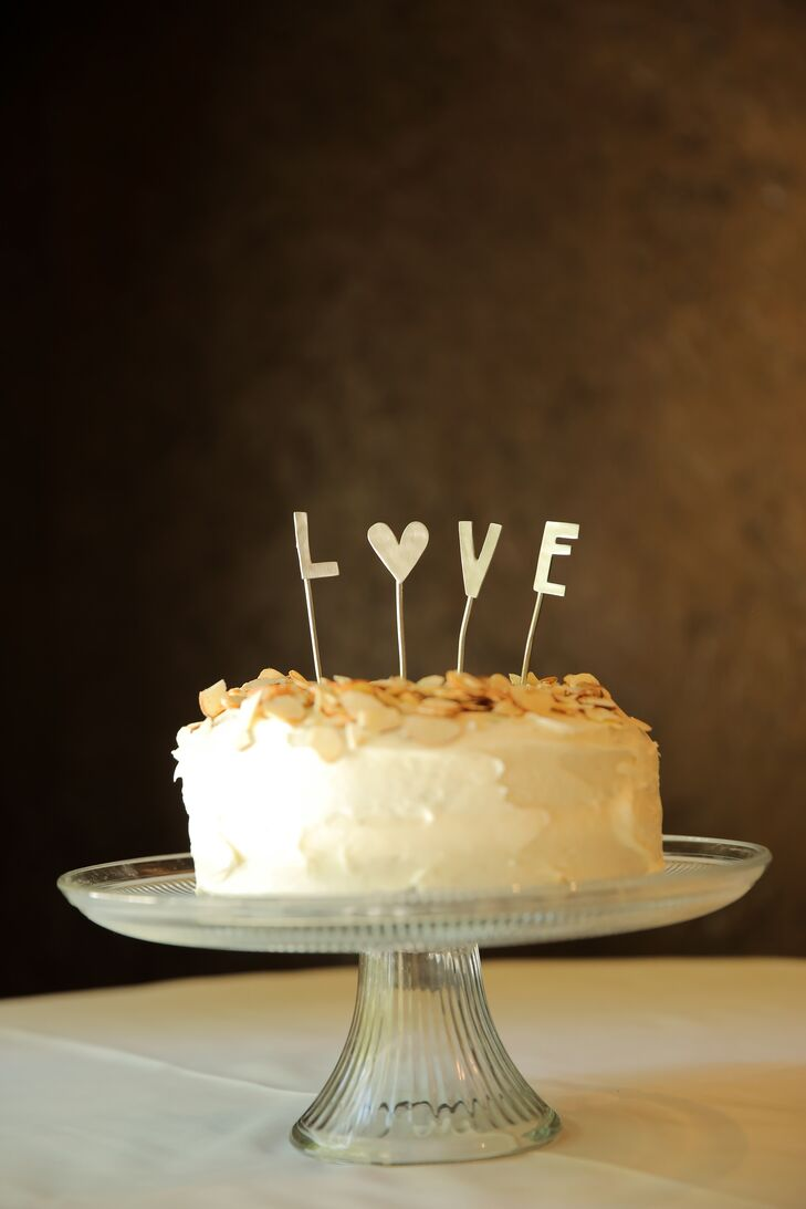 Although they didn't have a cake to serve to guests, the bride's mother made the couple a gluten-free chocolate cake to cut. Friends of the bride and groom made eclairs and chocolate pot de cremes for dessert.