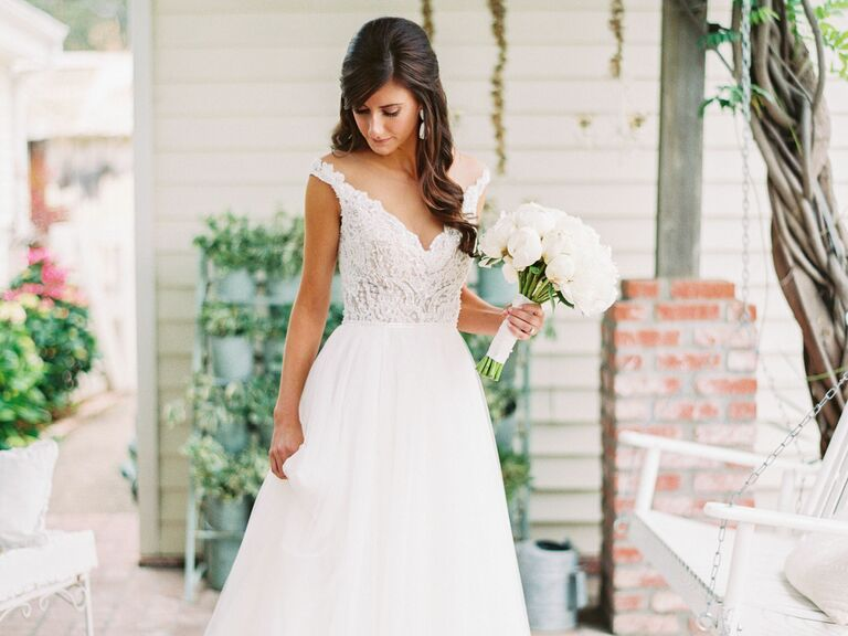 bride with loose curls and V-neck wedding dress