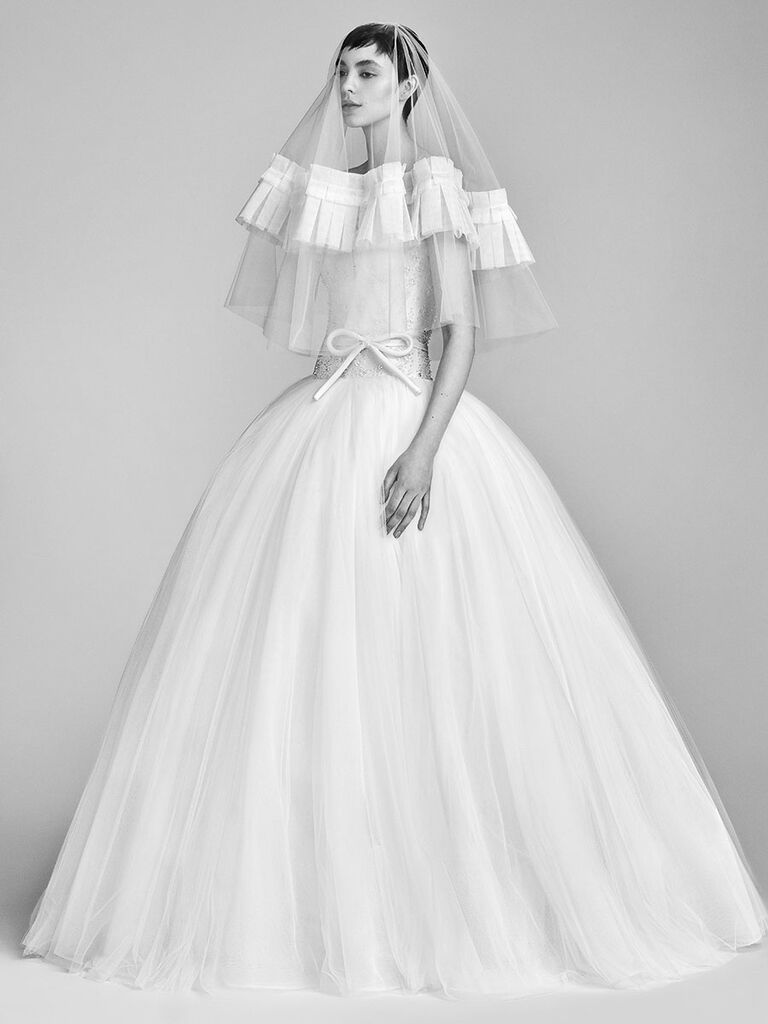 dacdde4ec56 Viktor   Rolf Spring 2018 white ball gown with delicate bow at the waist  and beaded