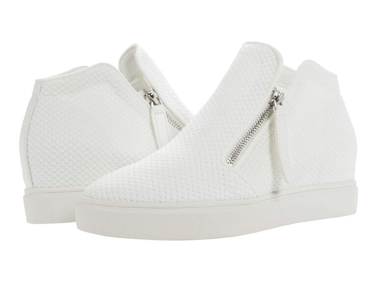 White textured sneaker wedges with zip closure