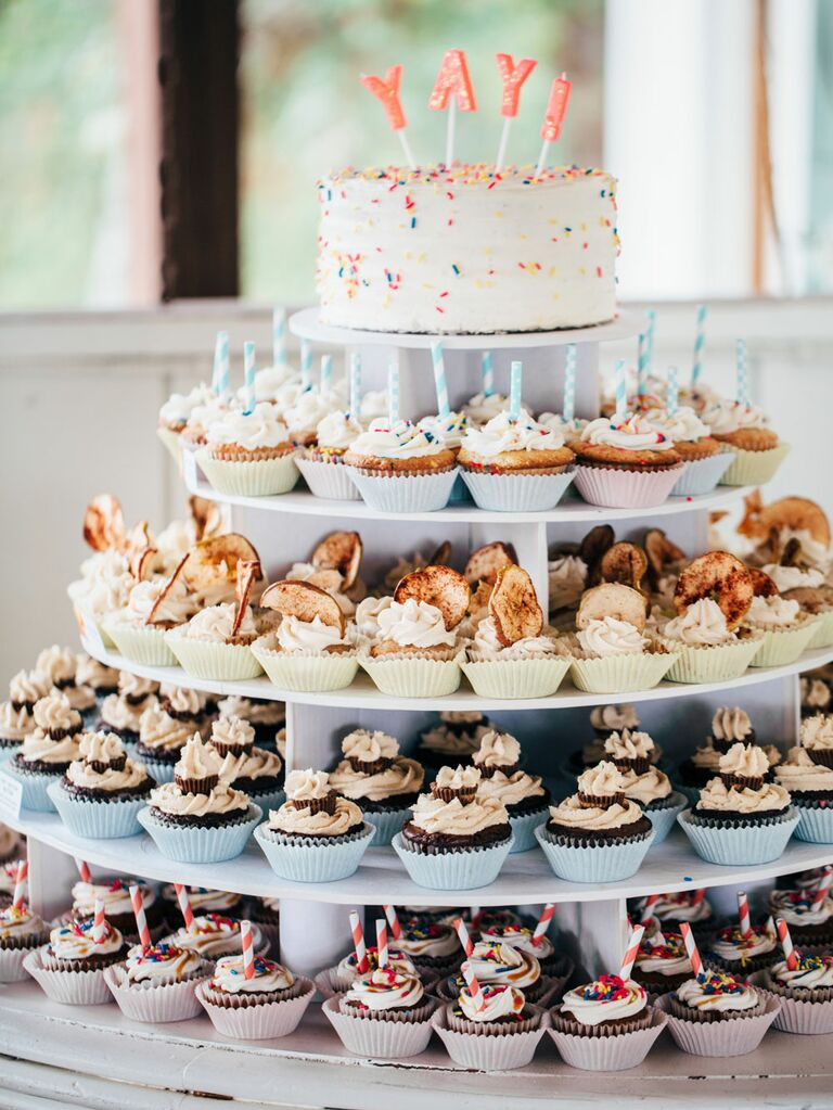 Assorted wedding cupakes on cake stand