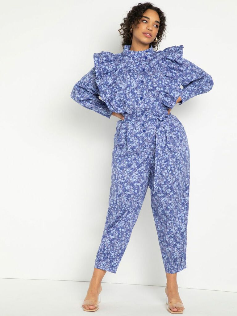 Blue floral cottagecore jumpsuit with long sleeves and statement ruffles on bodice