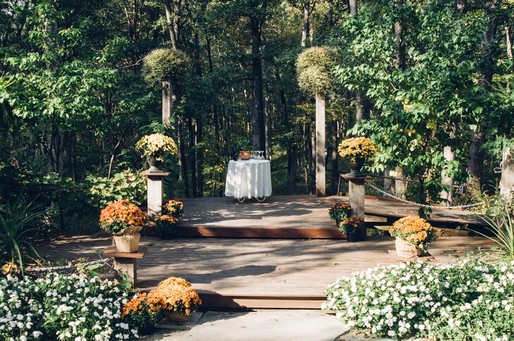 """We were blown away by all the natural elements that the park owner, Barry, had incorporated into his venue,"" Laura says. ""What really won us over was the outdoor amphitheater where we would say our vows. The guest seating is built into the landscape and the stage drops off into the woods creating a spectacular backdrop."""