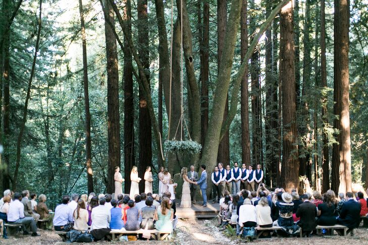 """""""Shiloh and his father built the ceremony space and benches from redwood trees on the property,"""" Liz says. """"We didn't decorate it much because it was beautiful as it was. We just added a grapevine wreath that I bound with fresh eucalyptus, and Shiloh suspended it from the tree with 100 feet of rope."""""""