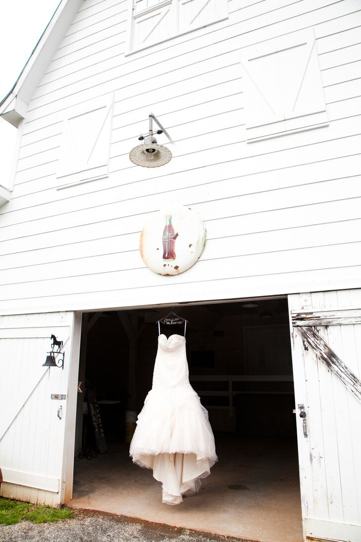 """""""My dress was totally not what I had invisioned wearing on my wedding day, but once I tried it on, I knew it was the perfect dress for me,"""" says Lindsey. """"My champagned colored dress was a fit and flare with a sweetheart neckline and lace up back."""""""