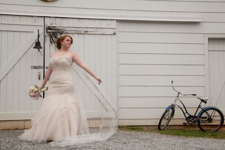 A cream cathedral length veil with lace edging completed Lindsey completed's romantic wedding look.