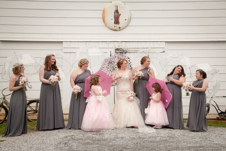 During pictures, Lindsey's bridesmaids used bright pink and clear umbrellas to shield their steel gray long gowns.