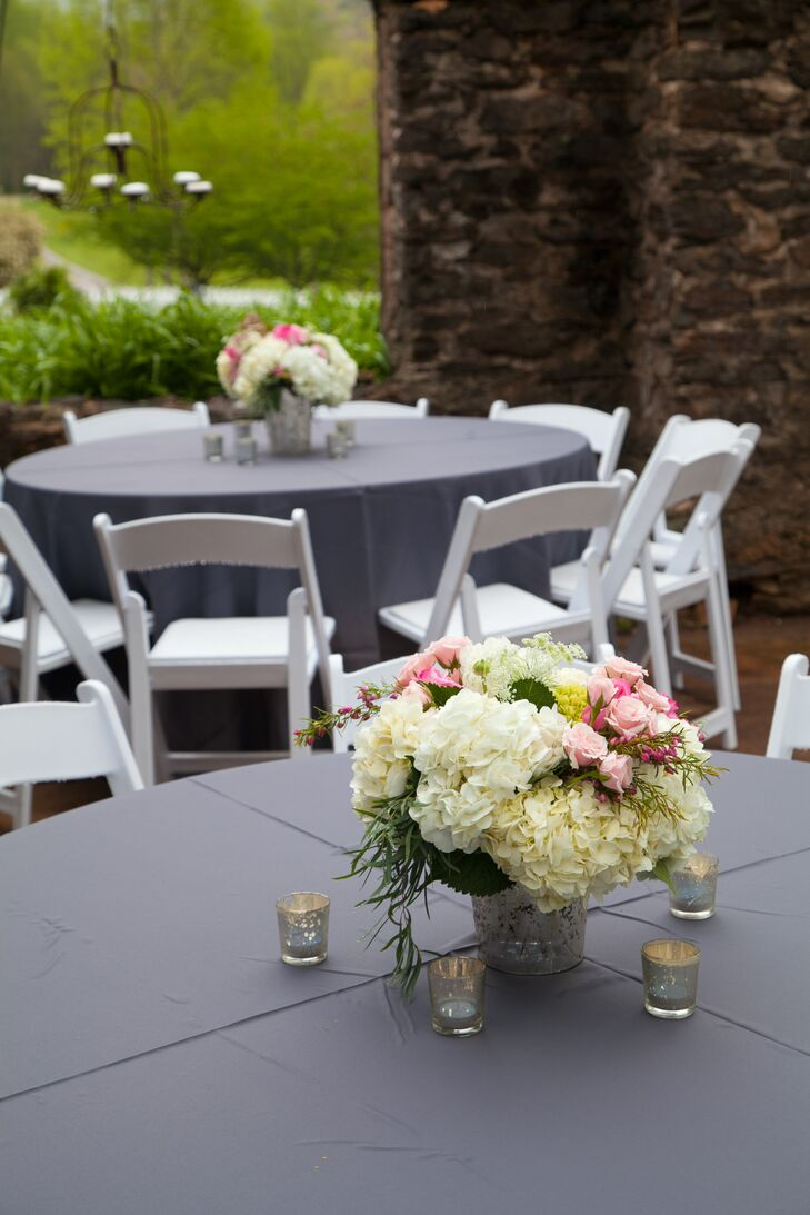 """""""Our guests munched on goodies during the cocktail hour before the reception to began inside the ruins,"""" says Lindsey. """"The tables were set with gray linens and gorgeous pink flower arrangements in mercury glass vases. """""""