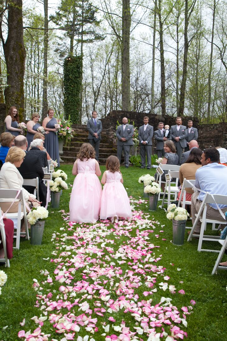 The flower girls wore pale pink dresses with full skirts and chiffon layers.
