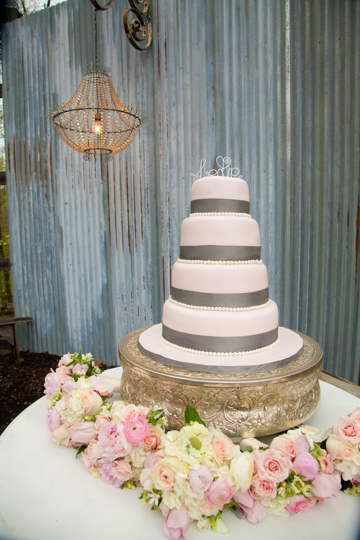 Smooth pink fondant with steel gray accents covered the four-tiered vanilla buttercream cake.