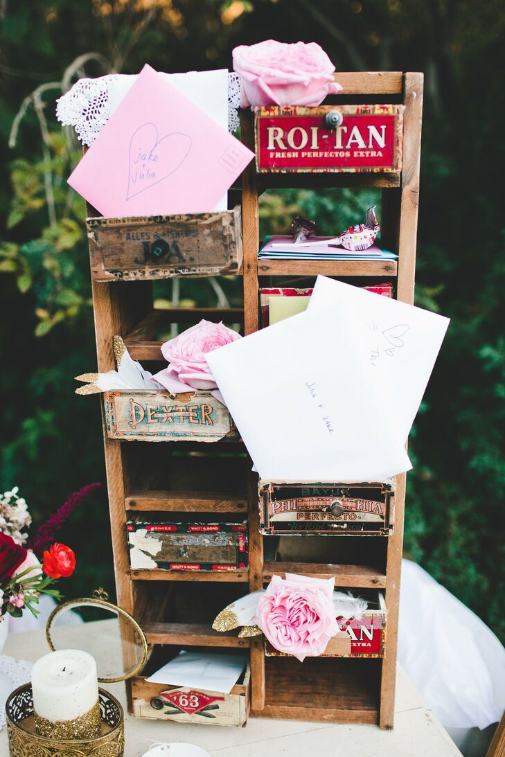 Guests could leave cards inside a cubby made from antique cigar boxes.