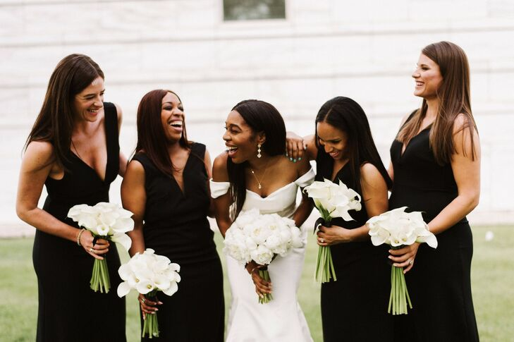 Elegant Bridesmaids in Black Dresses with White Calla Lily Bouquets