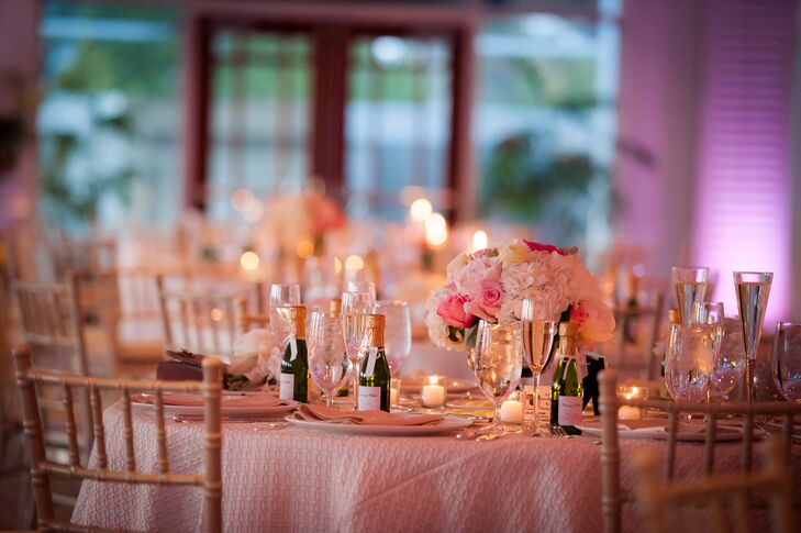 Reception Dinner Table With Mini Champagne Bottle Wedding Favors