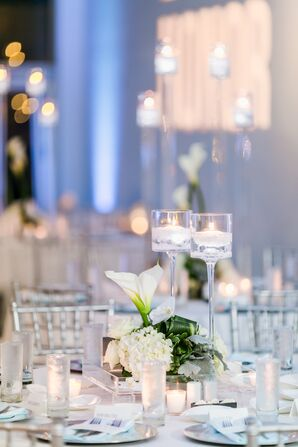 Low Orchid and Hydrangea Centerpiece with Tall Transparent Candles