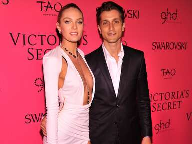 Candice Swanepoel and Hermann Nicoli pose at an event