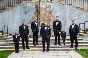 Groomsmen in Black Tuxedos and Vivid Fuchsia Boutonniers