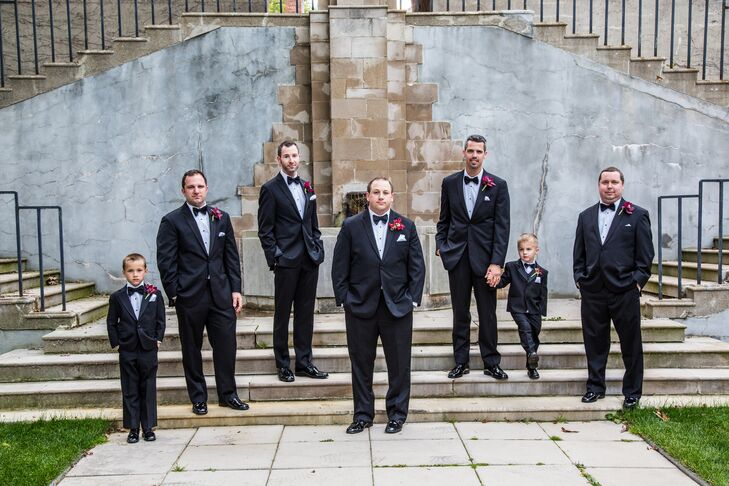 Matthew and his groomsmen wore black tuxedos with bow ties. They also wore fuchsia flower boutonnieres.