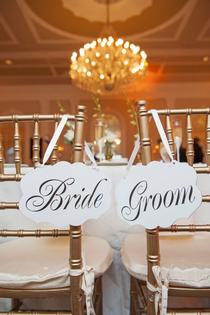 The bride and groom decorated their chairs with wooden bride and groom signs.