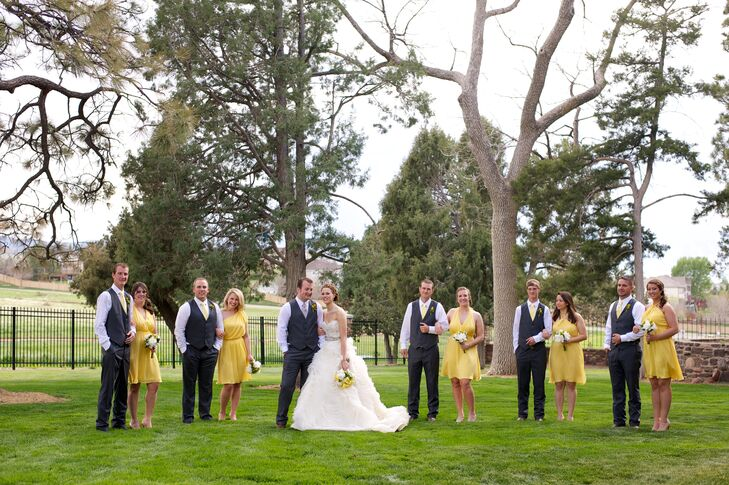 The bridesmaids chose casual yellow dresses, and the groomsmen wore gray suits without jackets and with yellow ties.