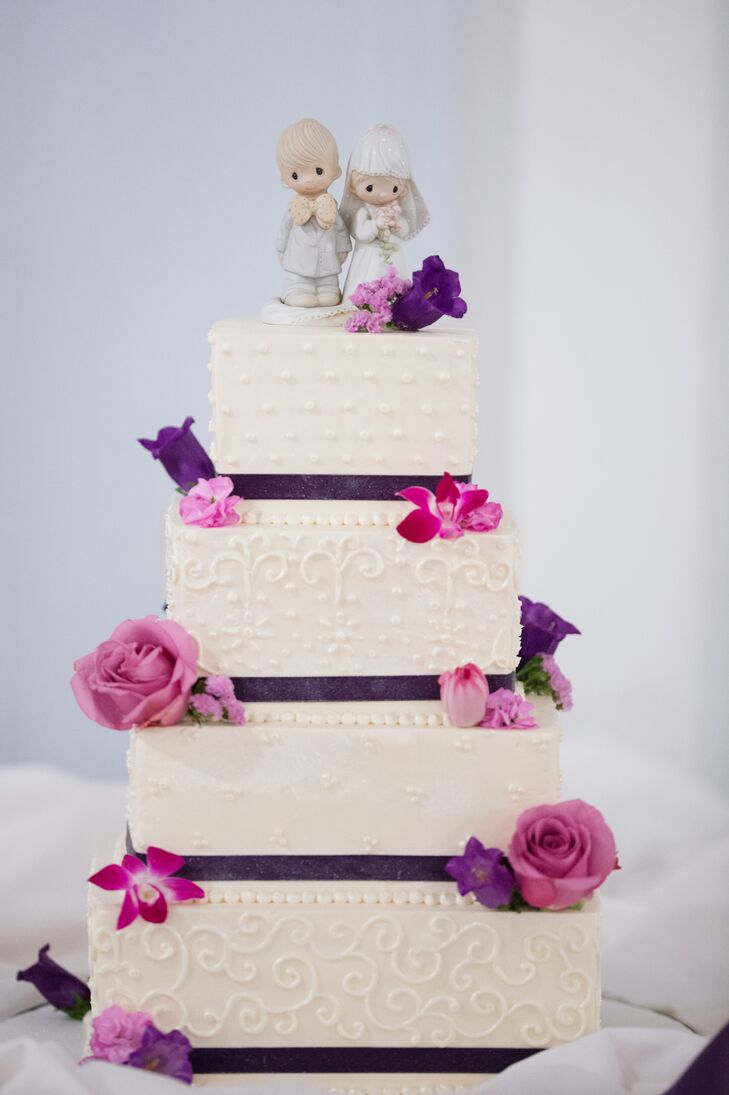 Square Tiered White Cake With Pink And Purple Flowers And Heirloom