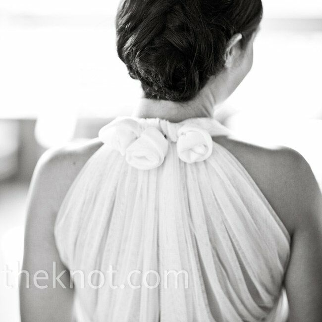 Annie knew she needed a unique but simple gown to compliment her petite frame. When she saw the gathered English lace on the back of the Vera Wang dress, she was sold.