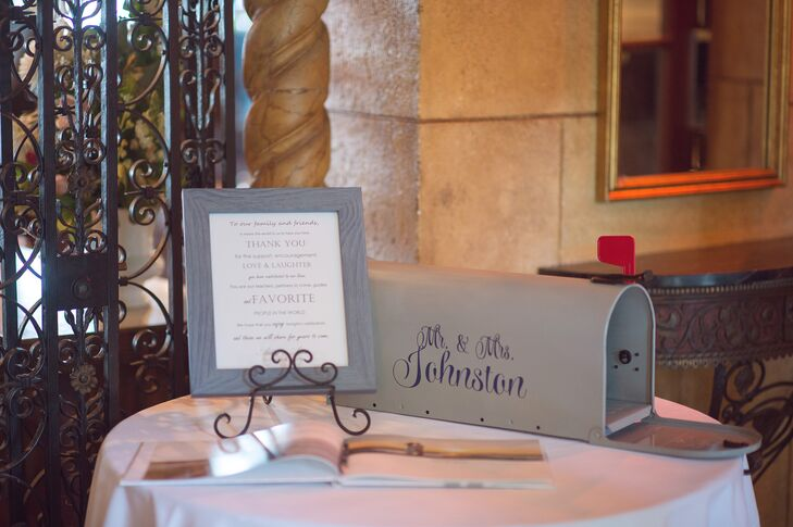 The couple had a traditional guest book for their friends and family to sign. It was accented with a custom silver metal mailbox.