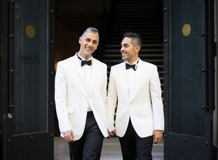 Touches of gold accented the black-and-white palette of Carlos Ortiz (above right, 42 and a senior designer) and Michael Maya's (36 and works in execu