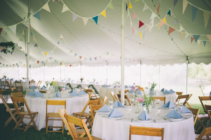 "In keeping with their ""England meets Kentucky"" theme, the tented wedding was filled with bunting (handmade in England), string lights, bourbon barrels, vintage inspired details and greenery."