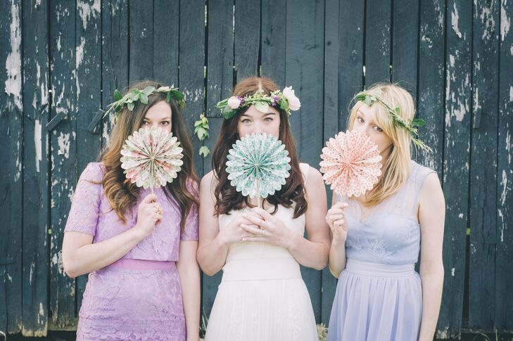 """I've always been a fan of mismatched bridesmaids dresses and I wanted their looks to be a collaborative effort that married our style and their personalities,"" says Cassie. Using our wedding palette as a starting point, the women wore feminine dresses in various shades of purple and for a very romantic and English look, my florist crafted gorgeous green halos."""